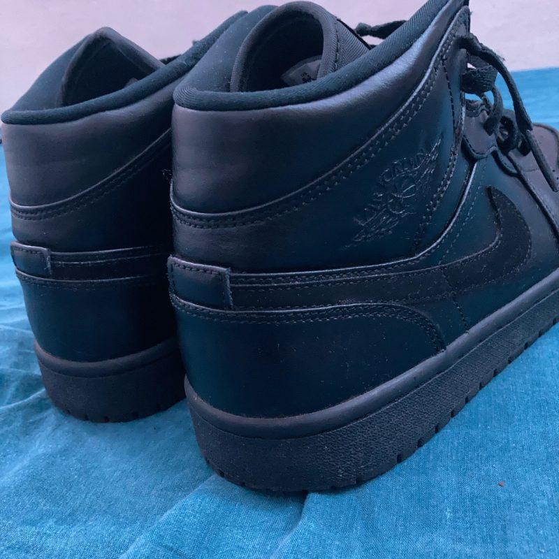 All black Jordan 1s